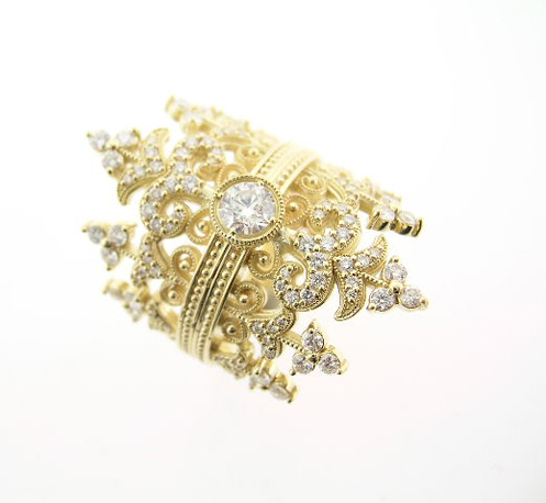 Ring in 18k yellow gold has 1.34 cts. t.w. diamonds; $6,300. Norman Covan