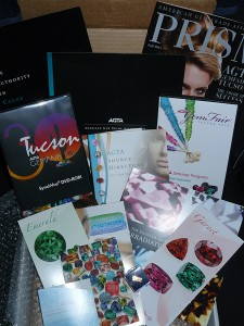 My box of swag, brochures, DVDs and goodies from AGTA