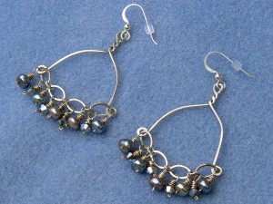 Earrings, sterling silver wire, freshwater button pearls, and Swarovski crystals.