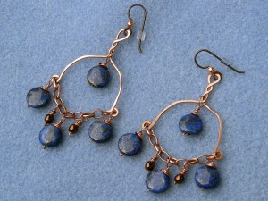 Earrings, copper wire, lapis lazuli, and bronze glass beads.