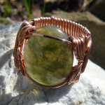 Copper wirework ring with moss agate