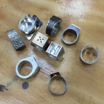 An assortment of hollow box rings, in various stages of completion and decoration.