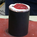 The molten top is actually borax glass, from the flux used in the crucible.