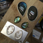 Stones with bezels and decorative borders.